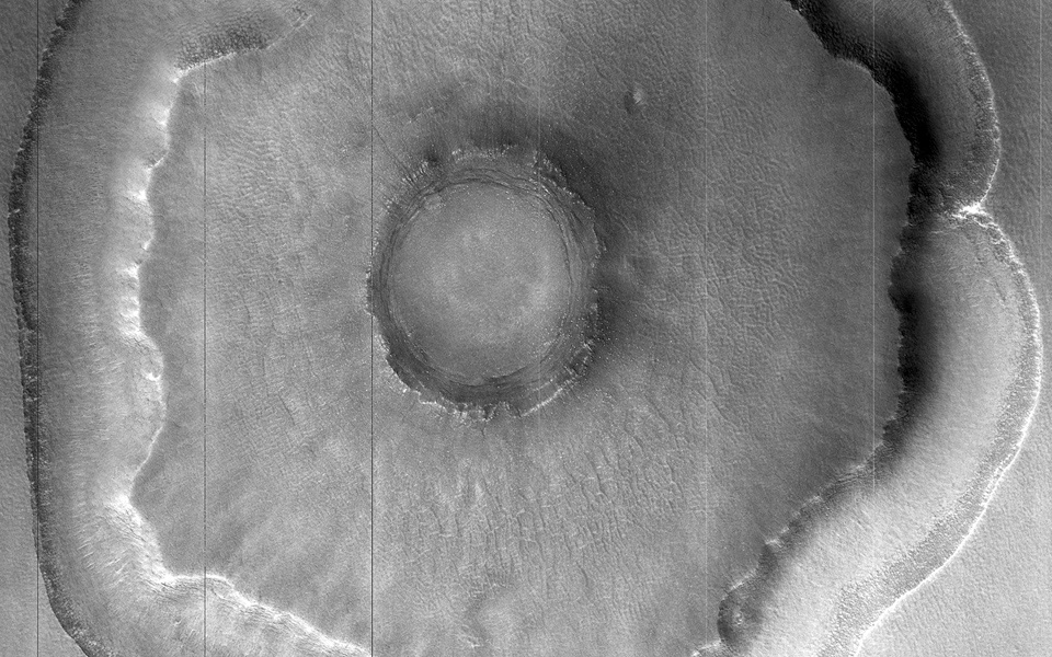Does this observation from NASA's Mars Reconnaissance Orbiter show a possible proto-pedestal crater? This crater has a ring trough, but the inner circle around the crater does not appear significantly elevated.