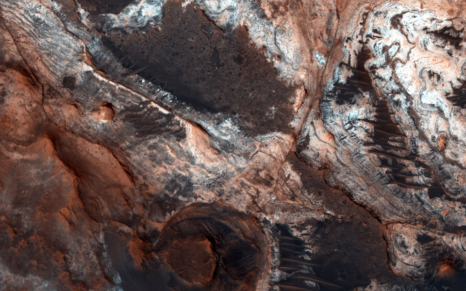 This observation from NASA's Mars Reconnaissance Orbiter shows a small portion of Mawrth Vallis, one of the many outflow channels feeding north into the Chryse Basin. This ancient valley once hosted flowing water.