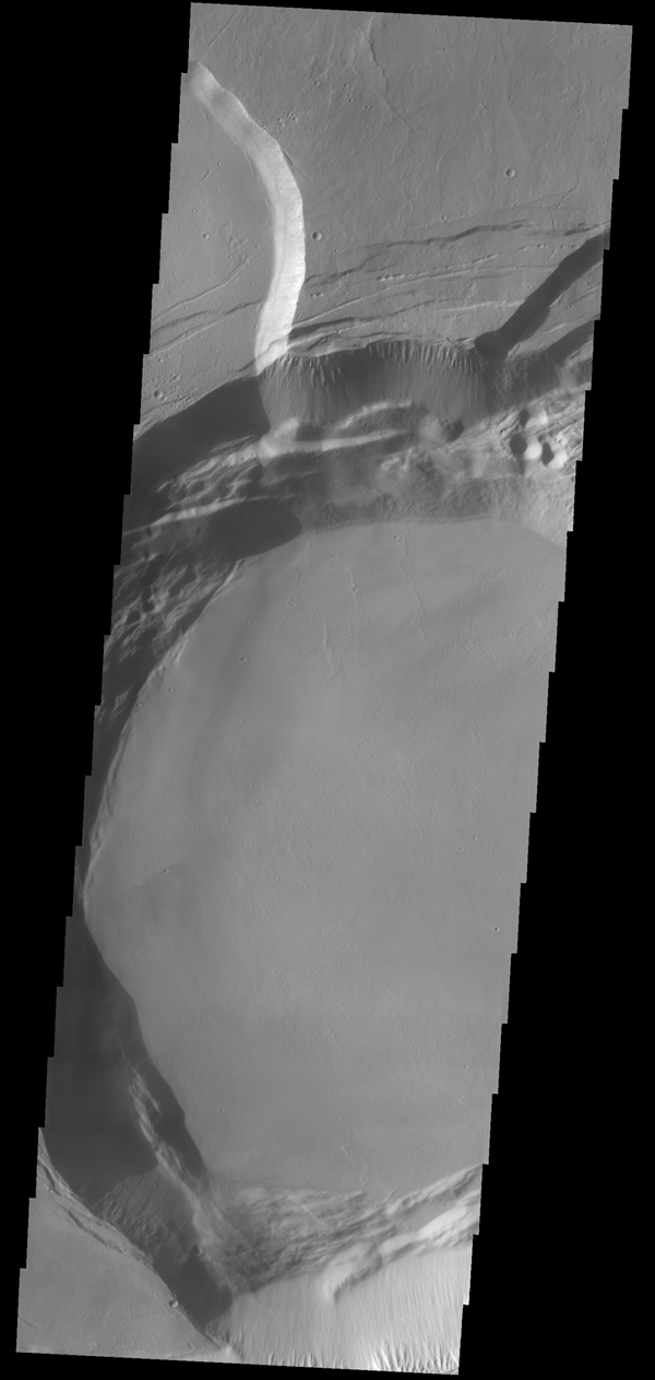 This image captured by NASA's 2001 Mars Odyssey spacecraft shows part of the summit caldera of Ascraeus Mons.