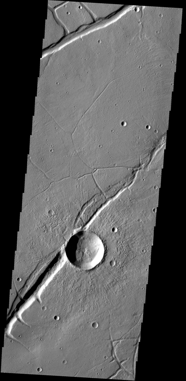 The fractures in this image captured by NASA's 2001 Mars Odyssey spacecraft are part of Labeatis Fossae. The large impact crater was formed after the fractures.