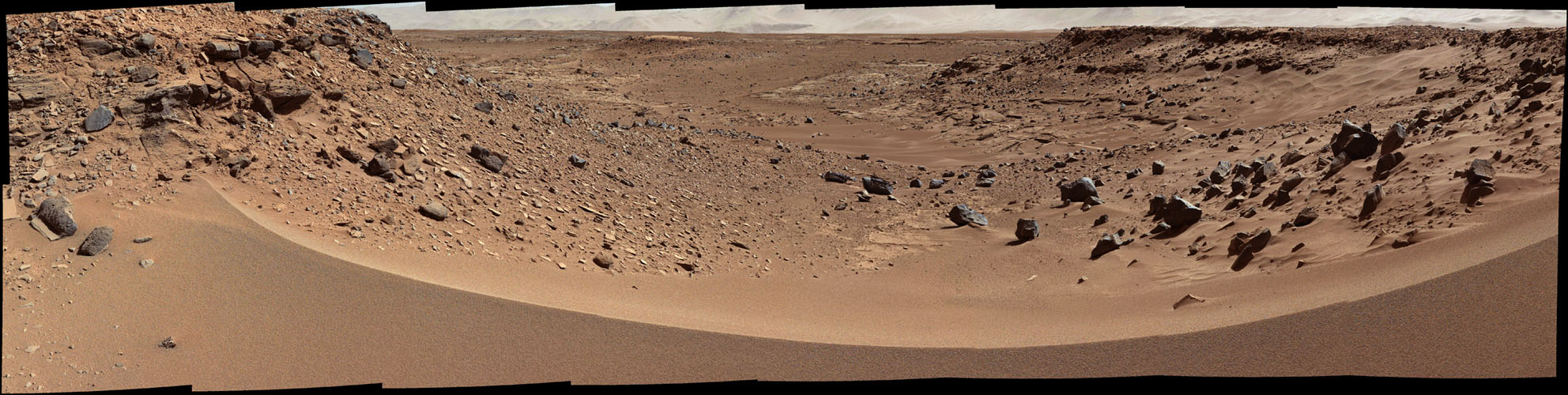This view combines several frames taken by NASA's Mars rover Curiosity, looking into a valley to the west from the eastern side of a dune at the eastern end of the valley.