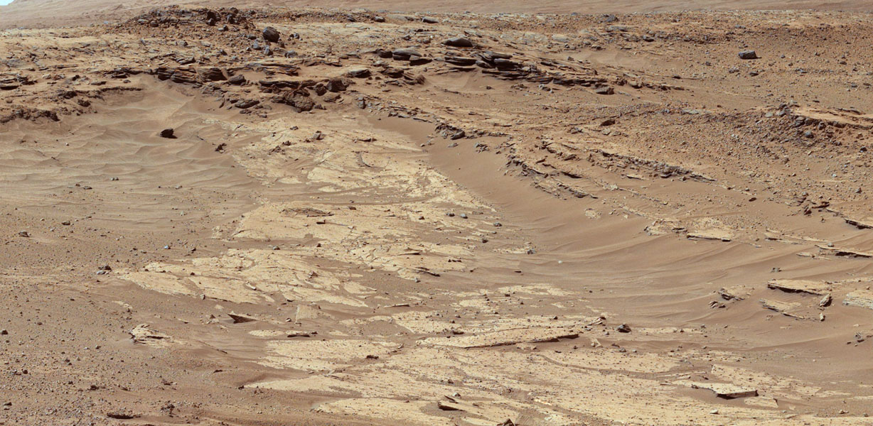 "Sandstone layers with varying resistance to erosion are evident in this Martian scene recorded by the Mast Camera on NASA's Curiosity Mars rover on Feb. 25, 2014, about one-quarter mile (about 400 meters) from a planned waypoint called ""the Kimberley."""