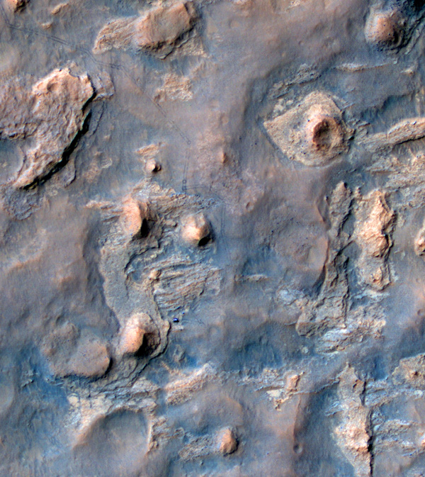 NASA's Curiosity Mars rover and tracks from its driving are visible in this view from orbit, acquired on April 11, 2014, by the High Resolution Imaging Science Experiment (HiRISE) camera on NASA's Mars Reconnaissance Orbiter.