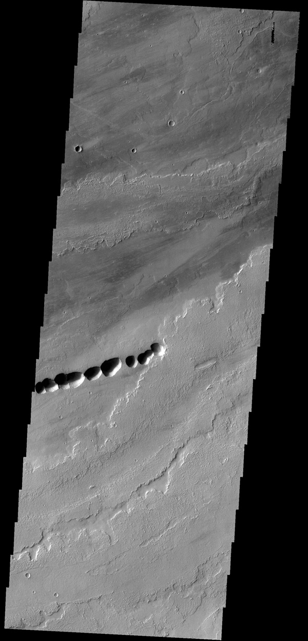The lava flows in this image from NASA's 2001 Mars Odyssey spacecraft most likely originated from Ascraeus Mons, one of the large Tharsis volcanos.