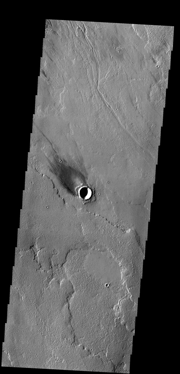 The windstreak in this image from NASA's 2001 Mars Odyssey spacecraft is located on Tharsis volcanic lava flows east of Olympus Mons.