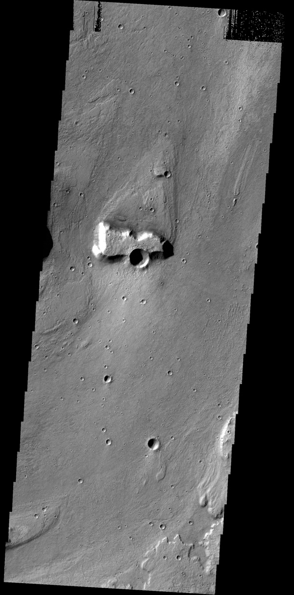 This image from NASA's 2001 Mars Odyssey spacecraft shows a streamlined island in a broad channel in Chryse Planitia. The channel is part of the outflow region of Lobo Vallis, a northern branch of Kasei Valles.