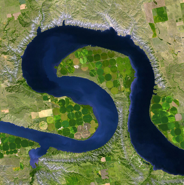 NASA's Terra spacecraft views central South Dakota, where the Missouri River forms a meander bend, creating Lake Sharpe. Eventually, the Missouri River will cut through the skinny peninsula, creating a shorter path.