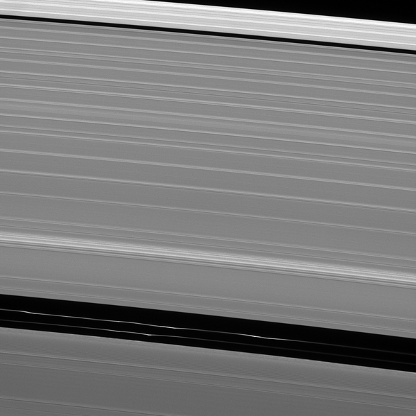 Although it appears empty from a distance, the Encke gap in Saturn's A ring has three ringlets threaded through it, two of which are visible here from NASA's Cassini spacecraft.