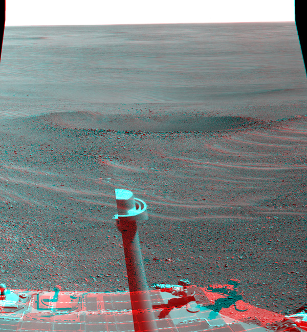 This stereo view from NASA's Opportunity rover shows 'Lunokhod 2 Crater,' which lies south of 'Solander Point' on the west rim of Endeavour Crater. Lunokhod 2 Crater is approximately 20 feet (6 meters) in diameter.