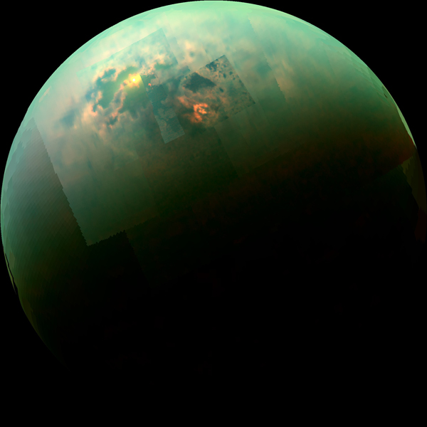 This near-infrared, color view from NASA'S Cassini orbiter shows the sun glinting off of Titan's north polar seas.