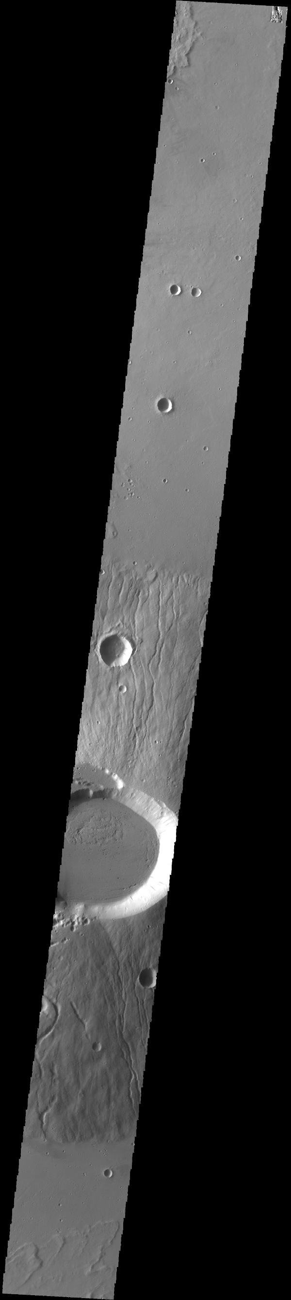 This image captured by NASA's 2001 Mars Odyssey spacecraft crosses the summit of Ceraunius Tholus.