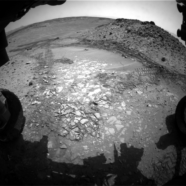 The pale rocks in the foreground of this Aug. 14, 2014, image from NASA's Curiosity Mars rover include the 'Bonanza King' target under consideration to become the fourth rock drilled by the rover.