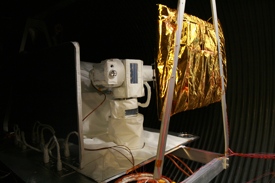 The Optical PAyload for Lasercomm Science (OPALS) flight terminal undergoes testing in a thermal vacuum chamber at NASA's Jet Propulsion Laboratory to simulate the space environment.