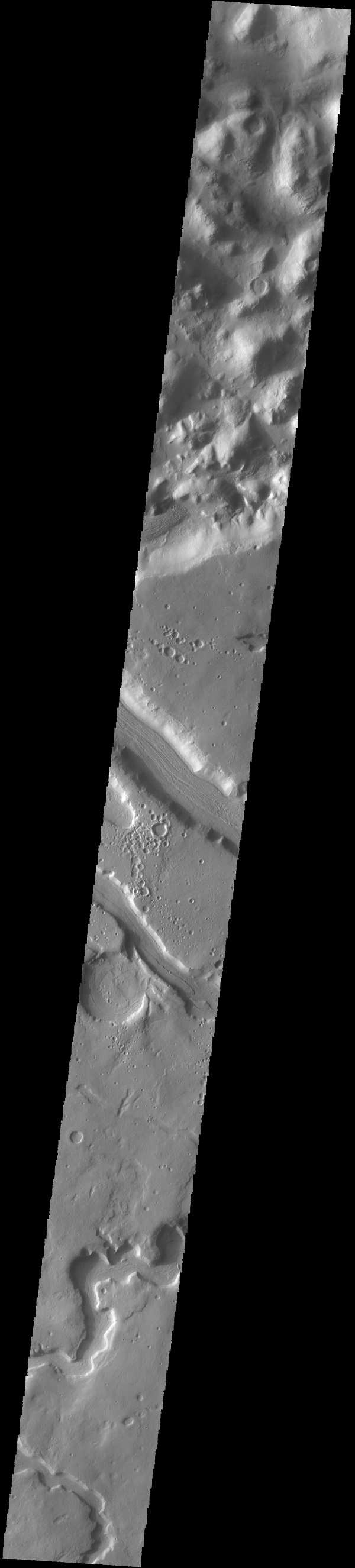 The sinuous channel at the bottom of this image captured by NASA's 2001 Mars Odyssey spacecraft is called Anio Valles.