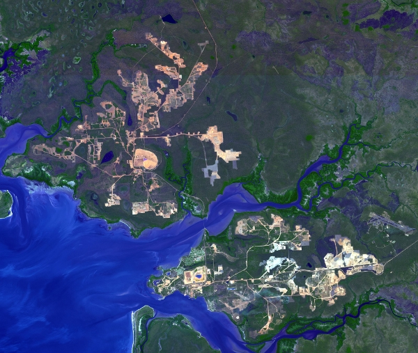 This image from NASA's Terra spacecraft shows the world's largest bauxite mine found near Weipa, Queensland, Australia. The rich aluminum deposits were first recognized on the end of the Cape York Peninsula in 1955, and mining began in 1960.