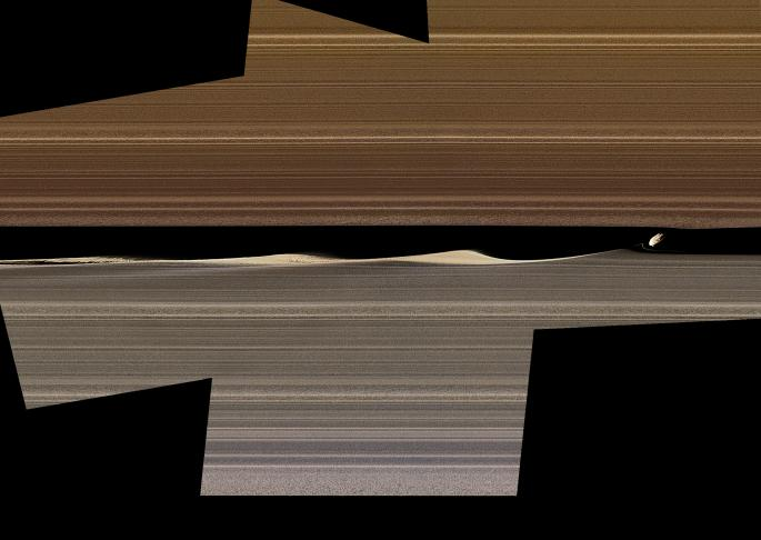 NASAs Cassini spacecraft shows this enhanced-color image mosaic of Daphnis, one of the moons embedded in Saturns rings.