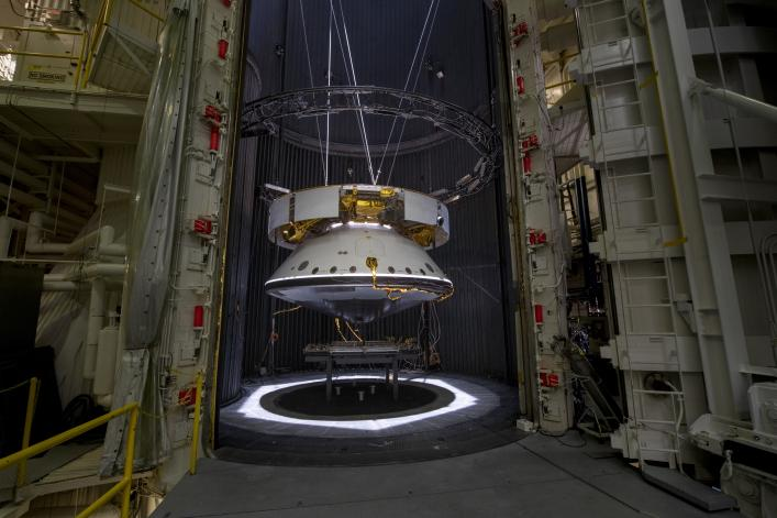 The completed spacecraft that will carry the Mars 2020 rover to the Red Planet, next year hangs suspended by cables inside the Space Simulator Facility at NASAs Jet Propulsion Laboratory in Pasadena, California. The image was taken on May 9, 2019.