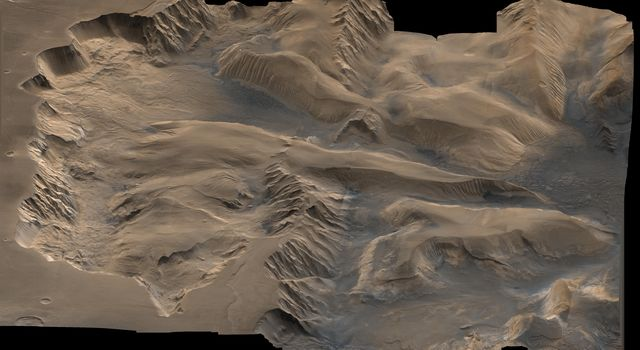 An oblique, color image of central Valles Marineris, Mars showing relief of Ophir and Candor Chasmata; view toward east. The photograph is a composite of NASA's Viking high-resolution images in black and white and low-resolution images in color.