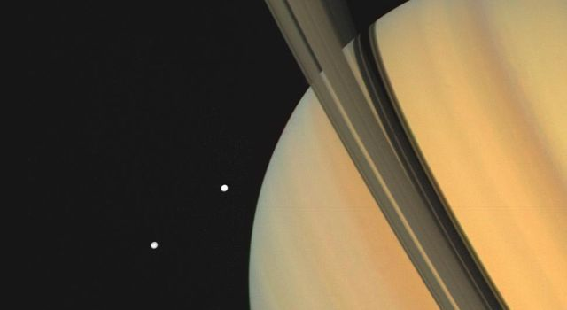 Saturn and two of its moons, Tethys (above) and Dione, were photographed by NASA's Voyager 1 on November 3, 1980, from 13 million kilometers (8 million miles).
