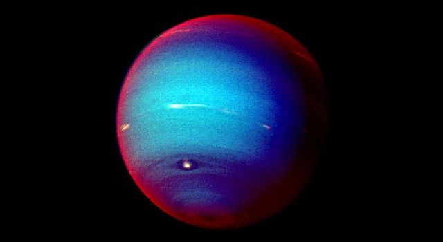This false color photograph of Neptune was made from Voyager 2 images taken through three filters: blue, green, and a filter that passes light at a wavelength that is absorbed by methane gas.