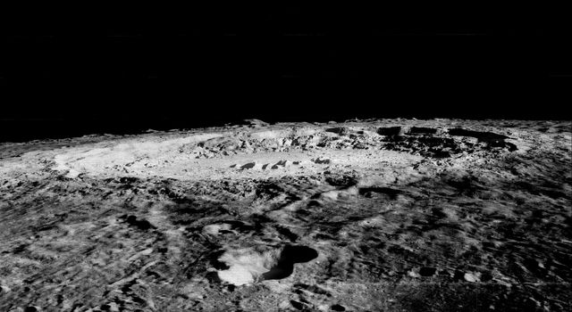 Copernicus is 93 km wide and is located within the Mare Imbrium Basin, northern nearside of the Moon (10 degrees N., 20 degrees W.). This image from NASA's Lunar Orbiter shows crater floor, floor mounds, rim, and rayed ejecta.