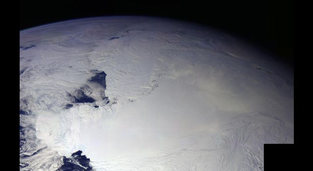 This color picture of Antarctica is one part of a mosaic of pictures covering the entire Antarctic continent taken during the hours following NASA's Galileo's historic first encounter with its home planet.