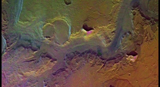 A conspicuous fretted channel, Reull Valles, Mars which dissects wall deposits of the large Hellas impact basin, trends southeast towards the basin floor as seen by NASA's Viking Orbiter 2.