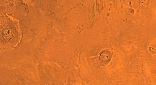 Mars digital-image mosaic merged with color of the MC-9 quadrangle, Tharsis region of Mars. This image is from NASA's Viking Orbiter 1.