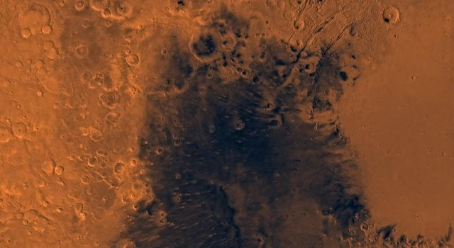 Mars digital-image mosaic merged with color of the MC-13 quadrangle, Syrtis Major region of Mars. This image is from NASA's Viking Orbiter 1.