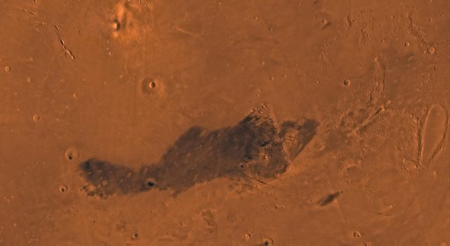Mars digital-image mosaic merged with color of the MC-15 quadrangle, Elysium region of Mars. This image is from NASA's Viking Orbiter 1.