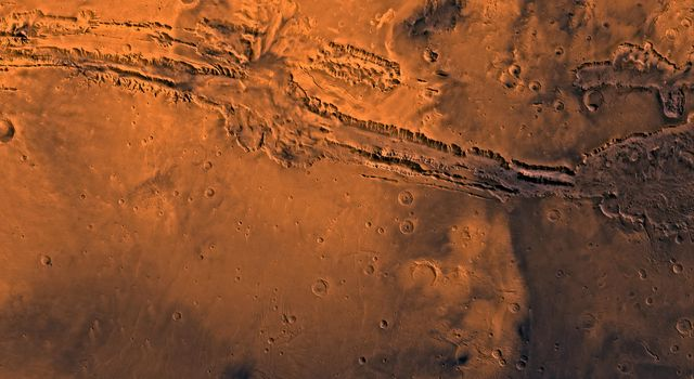Mars digital-image mosaic merged with color of the MC-18 quadrangle, Coprates region of Mars. This image is from NASA's Viking Orbiter 1.