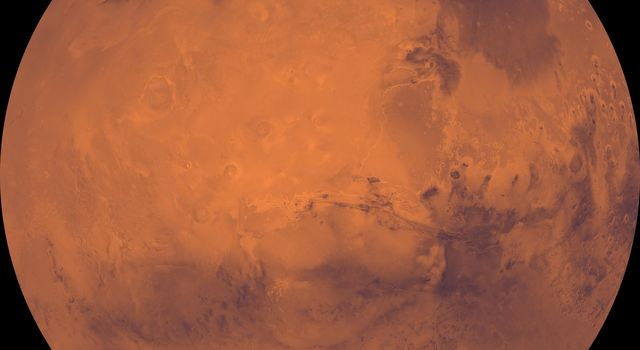 Both polar residual ice caps are seen at top and bottom. The central part is dominated by the four largest and youngest volcanoes on Mars--Olympus, Arsia, Pavonis, and Ascraeus Montes in this image from NASA's Viking Orbiter 1.