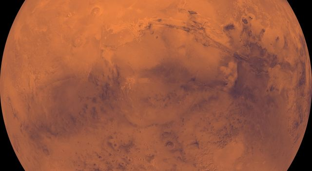 The top half of Mars is dominated by the Tharsis Montes volcanoes, the large Alba Patera shield volcano, the dark Chryse basin, and a vast canyon system, Valles Marineris in this image from NASA's Viking Orbiter 1.