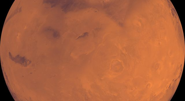 NASA's Viking Orbiter 1 spies the north polar residual ice cap, which is cut by spiral-patterned troughs and surrounded by the dark lowland plains of Vastitas Borealis, Mars is located at the top.