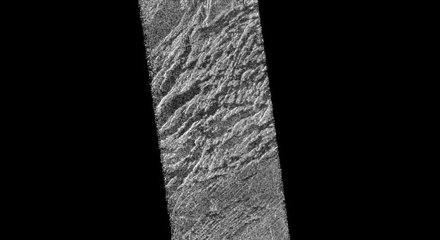 This portion of NASA's Magellan radar image strip shows a small region on Venus 20 kilometers (12.4 miles) wide and 75 km (50 miles) long on the east flank of a major volcanic upland called Beta Regio.
