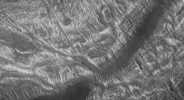 This image from NASA's Magellan shows part of the interior of Ovda Regio, one of the large highlands ringing the equator of Venus. Several tectonic events formed this complex block fractured terrain.