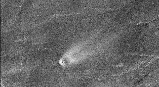 This comet-like tail, trending northeast from the volcanic structure, is a relatively radar-bright deposit. The volcano, with a base diameter of about 3 miles, is a local topographic high point that has slowed down northeast trending winds.
