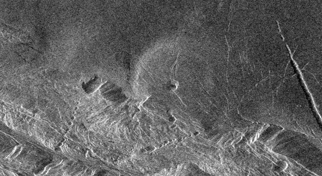 Southwest Lakshmi Planum (plains) is bounded on the south by the Danu Montes (mountains) as shown by NASA's Magellan spacecraft.