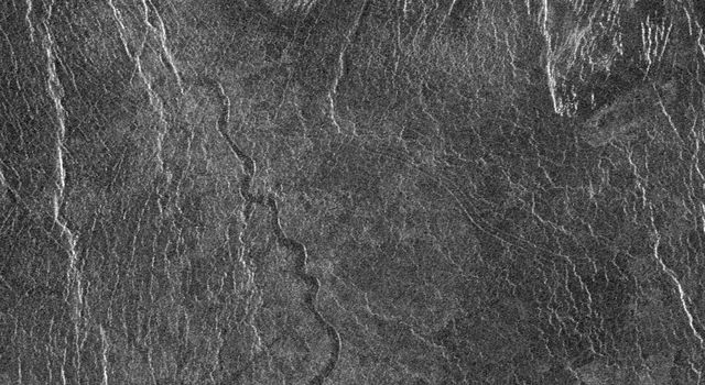 This full resolution radar mosaic from NASA's Magellan spacecraft shows a 200 kilometer (124 mile) segment of a sinuous channel on Venus.