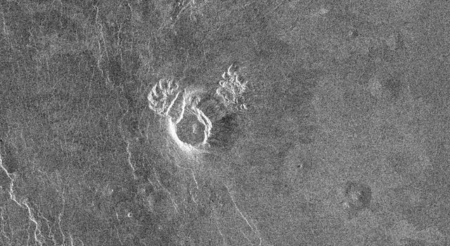 NASA's Magellan spacecraft observed remnant landslide deposits apparently resulting from the collapse of volcanic structures. This radar image is centered in the southwestern Navka Region of Venus.