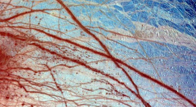 False color has been used here to enhance the visibility of certain features in this composite of three images of the Minos Linea region on Jupiter's moon Europa taken on 28 June 1996 by NASA's Galileo spacecraft.