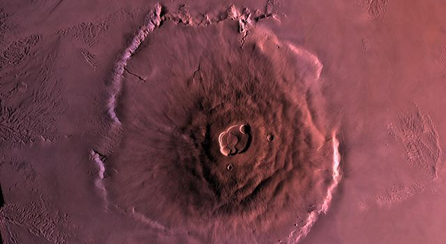 Shown here is a digital mosaic of Olympus Mons, the largest known volcano in the Solar System, as seen by NASA's Viking Orbiter 1. Much of the plains surrounding the volcano are covered by the ridged and grooved 'aureole' of Olympus Mons.