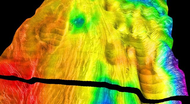 This perspective view of Venus, generated by computer from NASA's Magellan data and color-coded with emissivity, shows the boundary between the lowland plains and characteristic Venusian highland terrain in Ovda Regio.