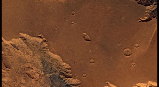 This image from NASA's Viking Orbiter 2 of West Candor Chasm shows parts of central Valles Marineris, including Candor Chasm (lower left), Ophir Chasm (lower right), and Hebes Chasm (upper right).