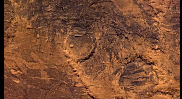 NASA's Viking Orbiter 2 shows Syria Planum-centered volcanism and tectonism produced fractures, narrow to broad grabens, large scarps, and broad fold and thrust ridges that deformed a basement complex.