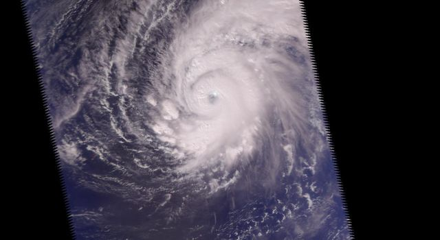 This image was made from data acquired by the Atmospheric Infrared Sounding System (AIRS) instrument suite aboard NASA's Aqua spacecraft in December, 2002, just as the eye of Supertyphoon Pongsona was about to pass over Guam.