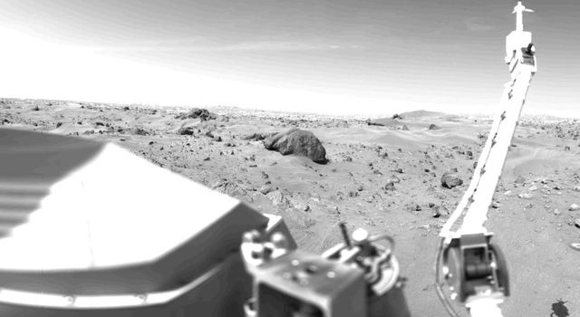 Sand dunes and large rocks are revealed in this panorama picture of Mars, the first photograph taken by NASA's Viking 1's Camera 1 on July 23, 1976. The horizon is approximately 3 kilometers (2 miles) away.