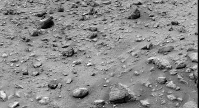 Photographic evidence of the successful series of commands to NASA's Viking 1 lander on Mars that unlocked the surface sampler arm is seen in this picture.