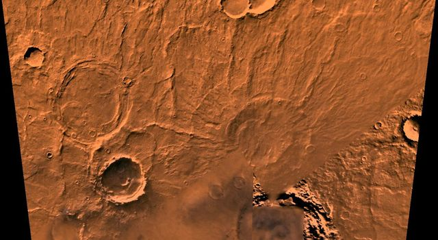 The Amphitrites Patera region of Mars. This scene shows several indistinct ring structures and radial ridges of an old volcano named Amphitrites Patera, as seen by NASA's Viking spacecraft.
