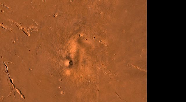 The Elysium Region of Mars; north toward top. This scene shows the Elysium Mons volcano (center), Hecates Tholus (to the north), Albor Tholus (to the south), and the depressions of Elysium Fossae, as seen by NASA's Viking spacecraft.